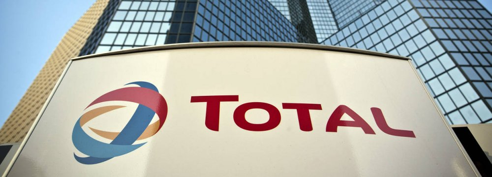 Total shares rise amid reports it has pulled out of its Iran gas field deal