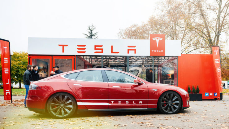 Tesla stock price advances as company cuts pay and furloughs hourly workers